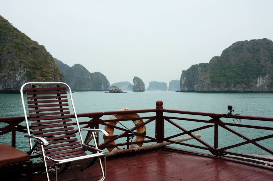 Beauty In Nature Boat Deck Chair Day Ha Long Bay Halong Halong Bay Vietnam Halongbay HalongbayCruise Mountain Nature No People Outdoors Scenics Sea Sky Water