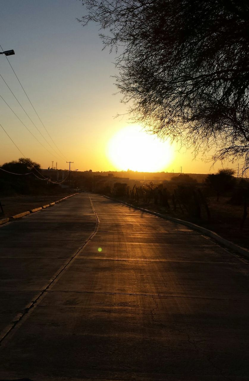 sunset, road, the way forward, sun, nature, no people, scenics, transportation, silhouette, tree, beauty in nature, sky, outdoors