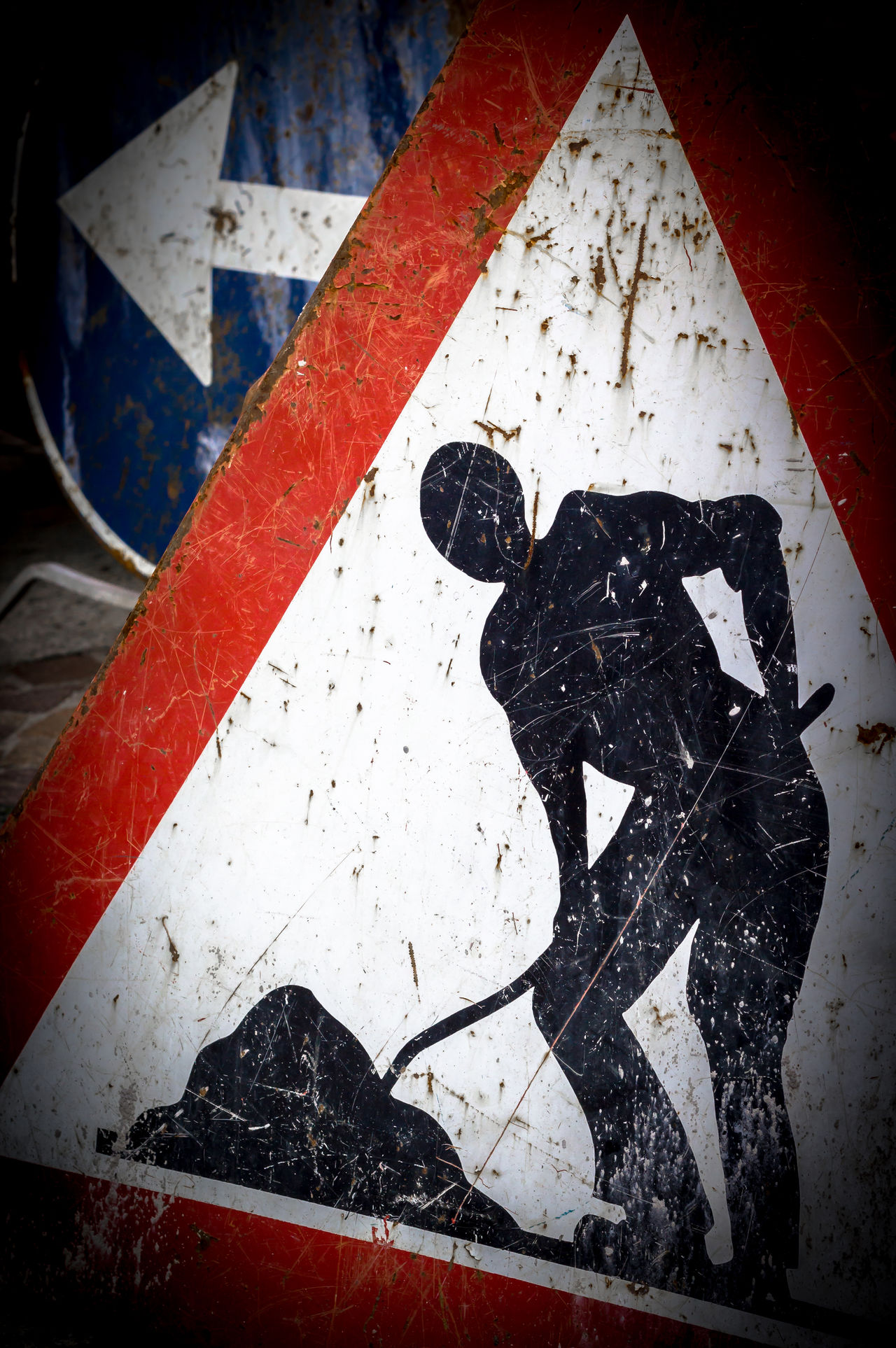 Road works sign at a construction site Alert Area Arrow Attention Caution ⚠️ Construction Site Danger Dipping Grungy Men At Work  Old Progress Red Roadside Roadworks Rusty Safety Scratched Sign Signal Symbol Triangle Warning Worker