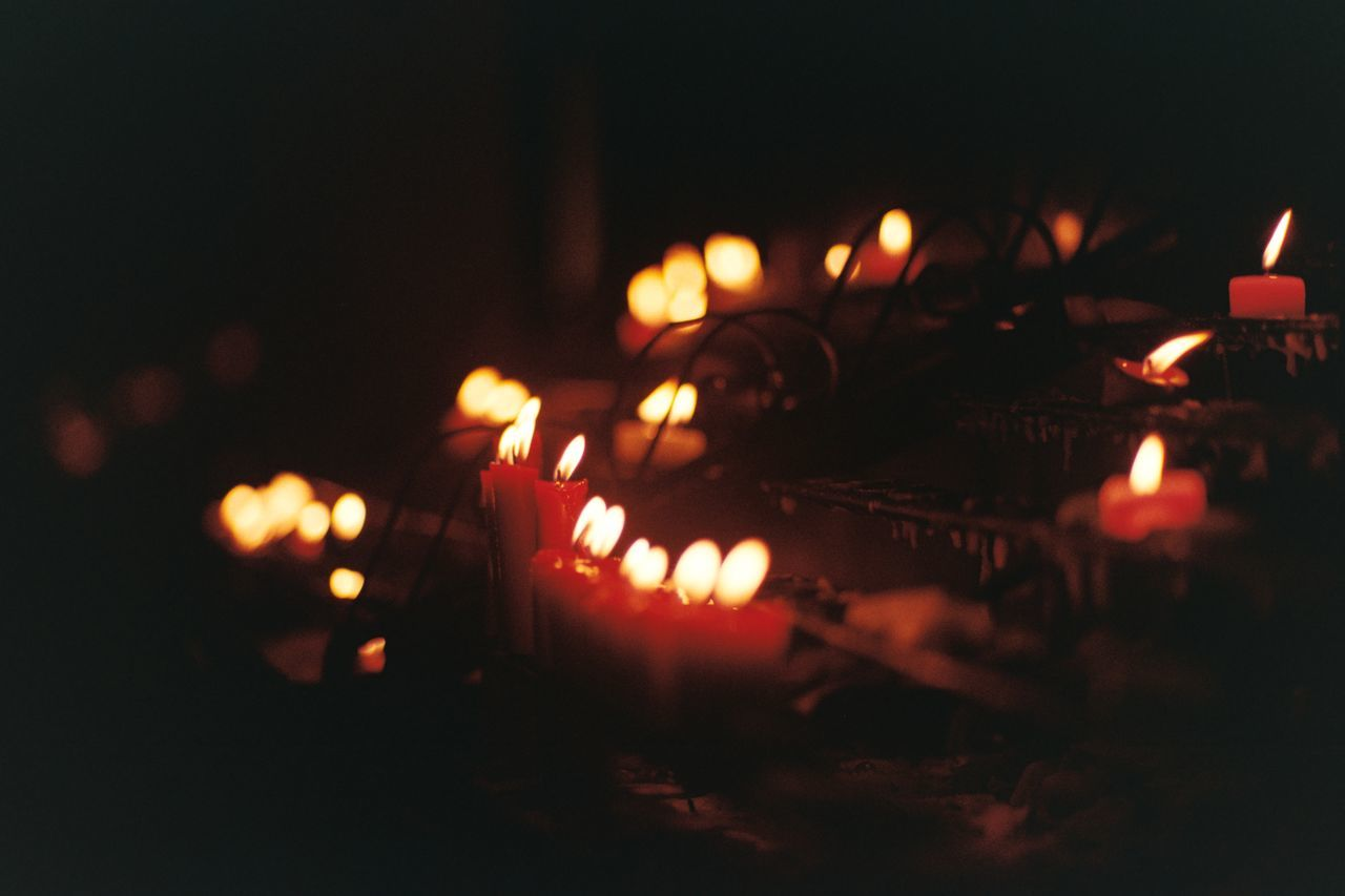 light and darkness Binondo Manila Philippines Burning Illuminated Candles Light Darkness Flame Olympus OM1 Olympus Om1 Unfiltered Unedited Film Is Not Dead Film Phoptography 35mm Film Film Photography