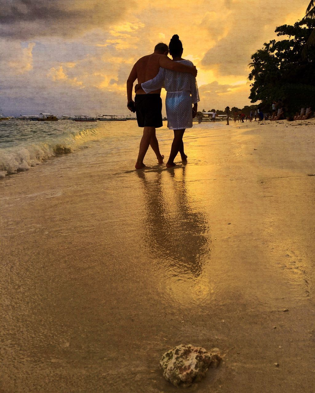 sunset, two people, love, togetherness, nature, real people, water, sky, sea, rear view, beach, walking, bonding, leisure activity, men, beauty in nature, full length, scenics, tranquil scene, outdoors, standing, vacations, tranquility, women, lifestyles, day, people