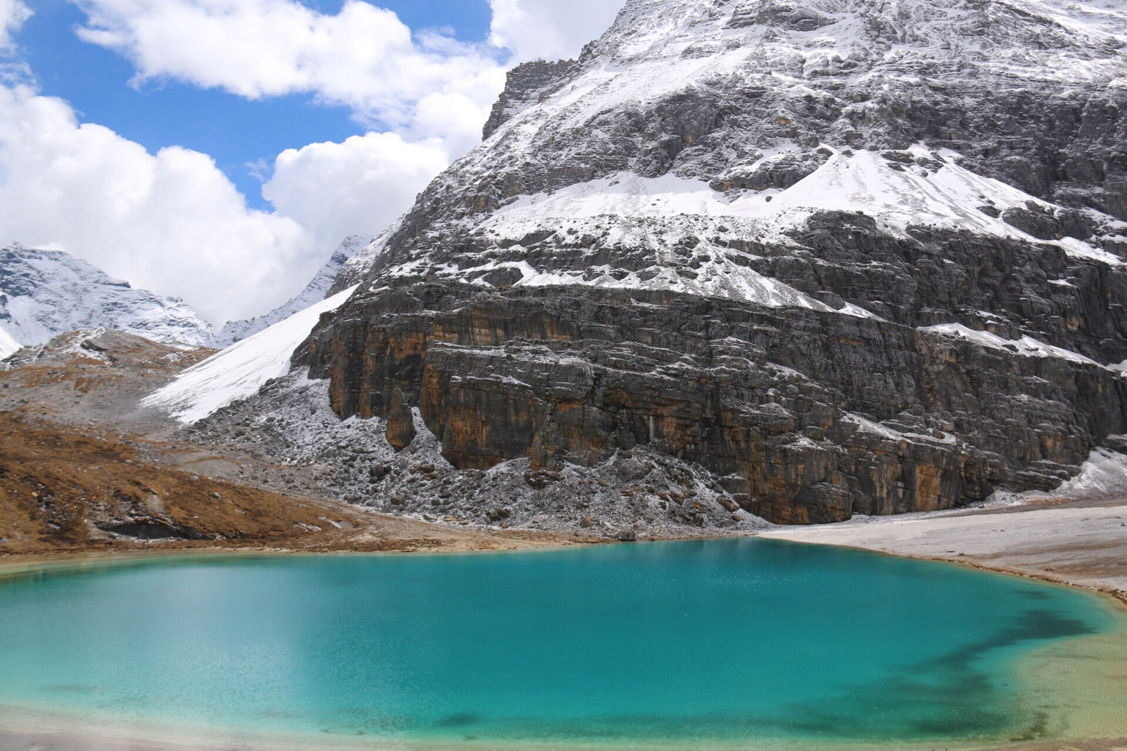 tranquil scene, snow, winter, cold temperature, scenics, water, season, mountain, tranquility, beauty in nature, weather, nature, sky, idyllic, lake, non-urban scene, snowcapped mountain, cloud - sky, majestic, remote, day, outdoors, mountain range, vacations, calm, rocky mountains, tourism, mountain peak, curve, solitude, no people