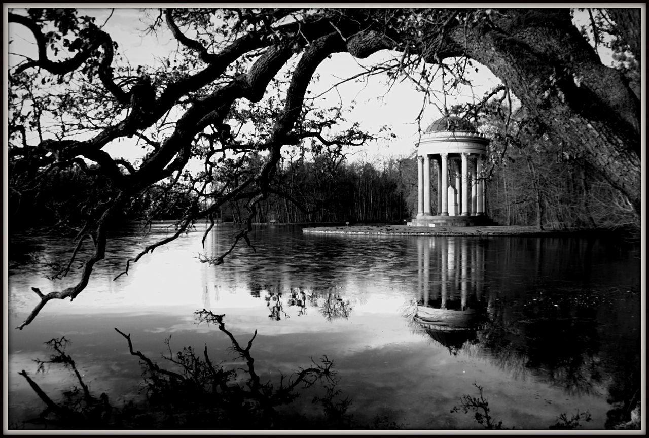 Reflection Of Trees And Gazebo On Lake