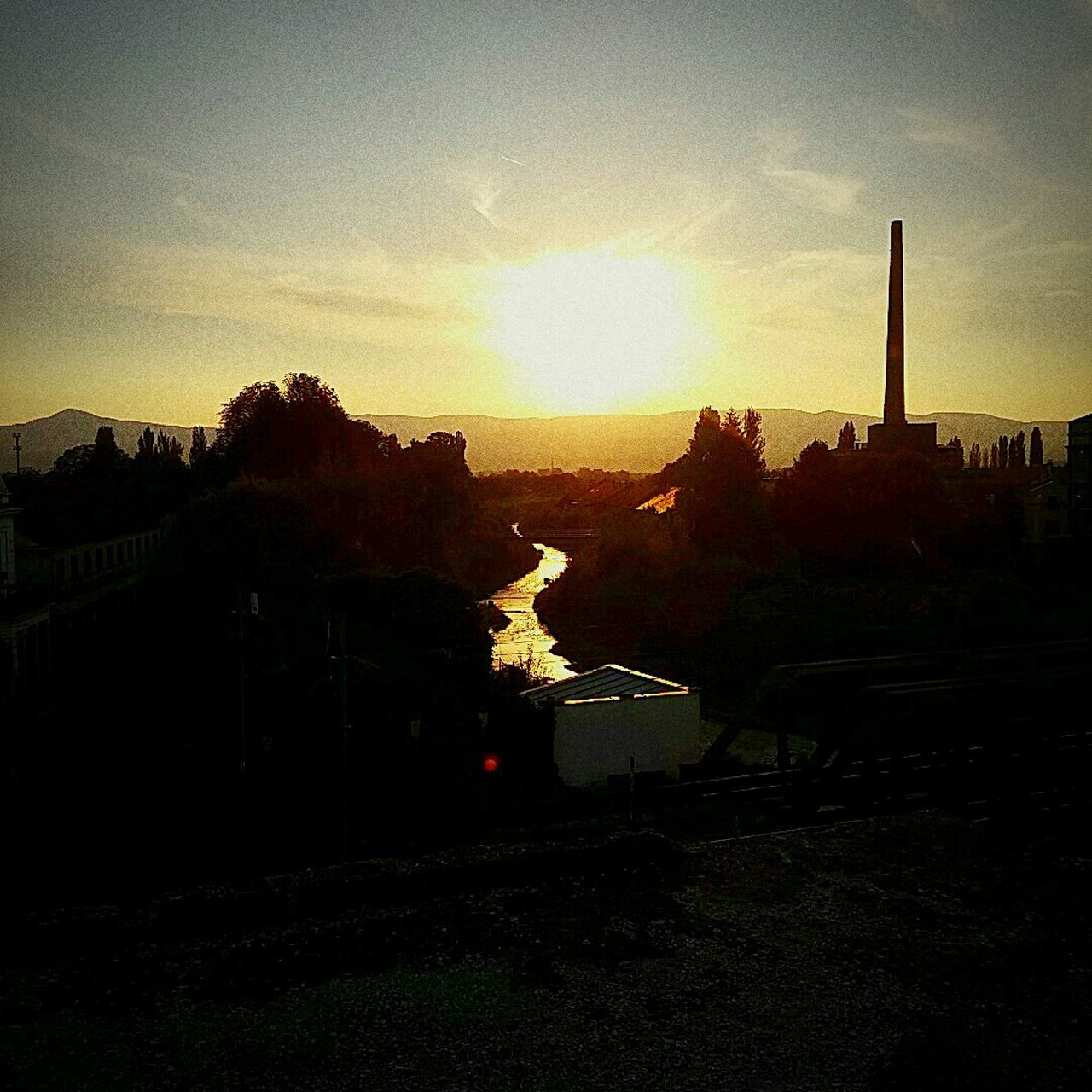 """Štofara"" old abandoned factory by 1990s Sunset Architecture Building Exterior Water Built Structure Sun High Angle View Sunset Architecture Building Exterior Water Built Structure Sun High Angle View Sky River Cloud - Sky Sunbeam Outdoors Canal Scenics Lens Flare No People Factory Zone Town"