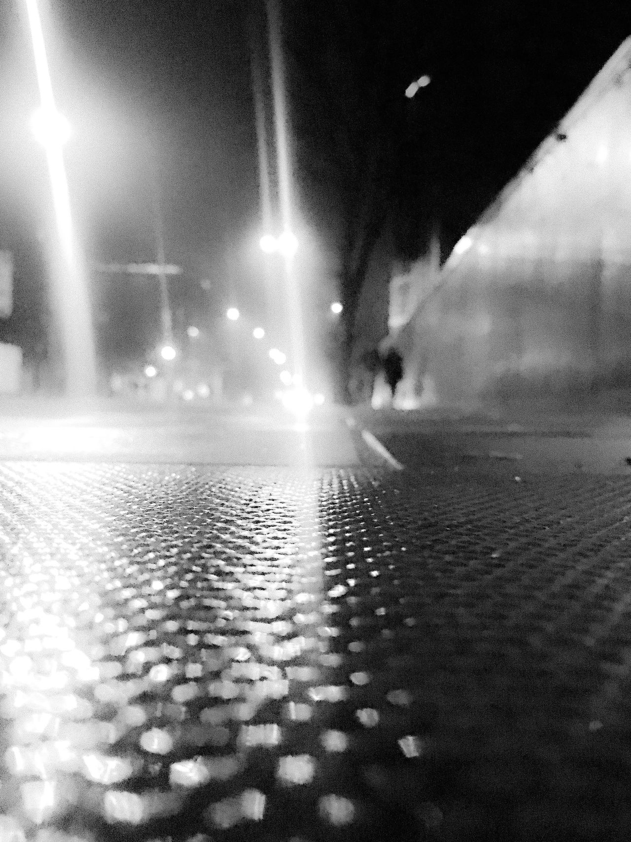 Street Scene Urban Exploration Night Mysterious Reflection EyeEm Best Shots - The Streets Illuminated Streetphotography EyeEm Best Shots Abstract Vanishing Point Artistic Atmospheric Mood Black And White Photography The Week Of Eyeem Fresh On Eyeem  Walking Silhouette Low Angle View