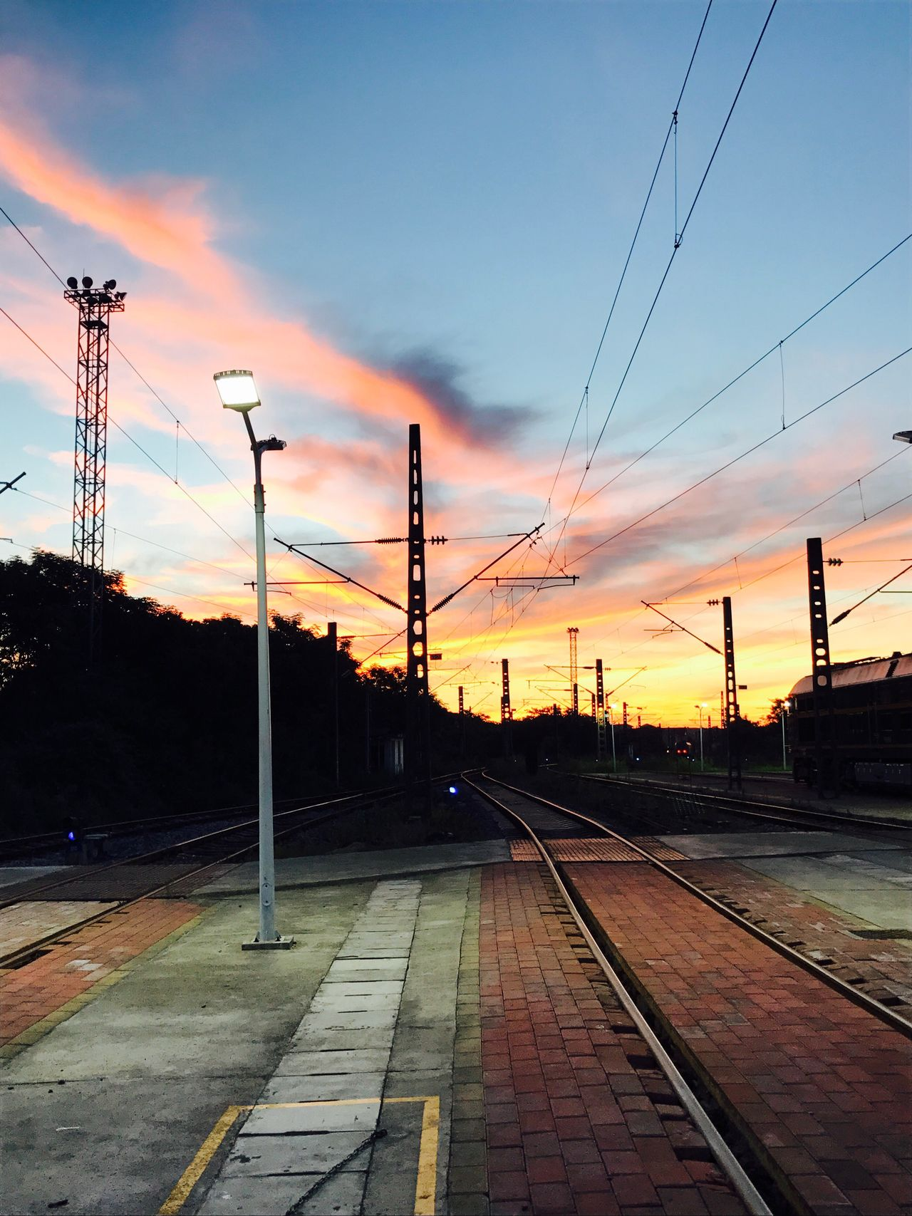No ps!It is nature! Rail Transportation Railroad Track Cable Sky Transportation Power Line  Electricity Pylon Sunset No People Railway Signal Electricity  Power Supply Cloud - Sky Railway Track Railway Public Transportation Outdoors Railroad Technology Day