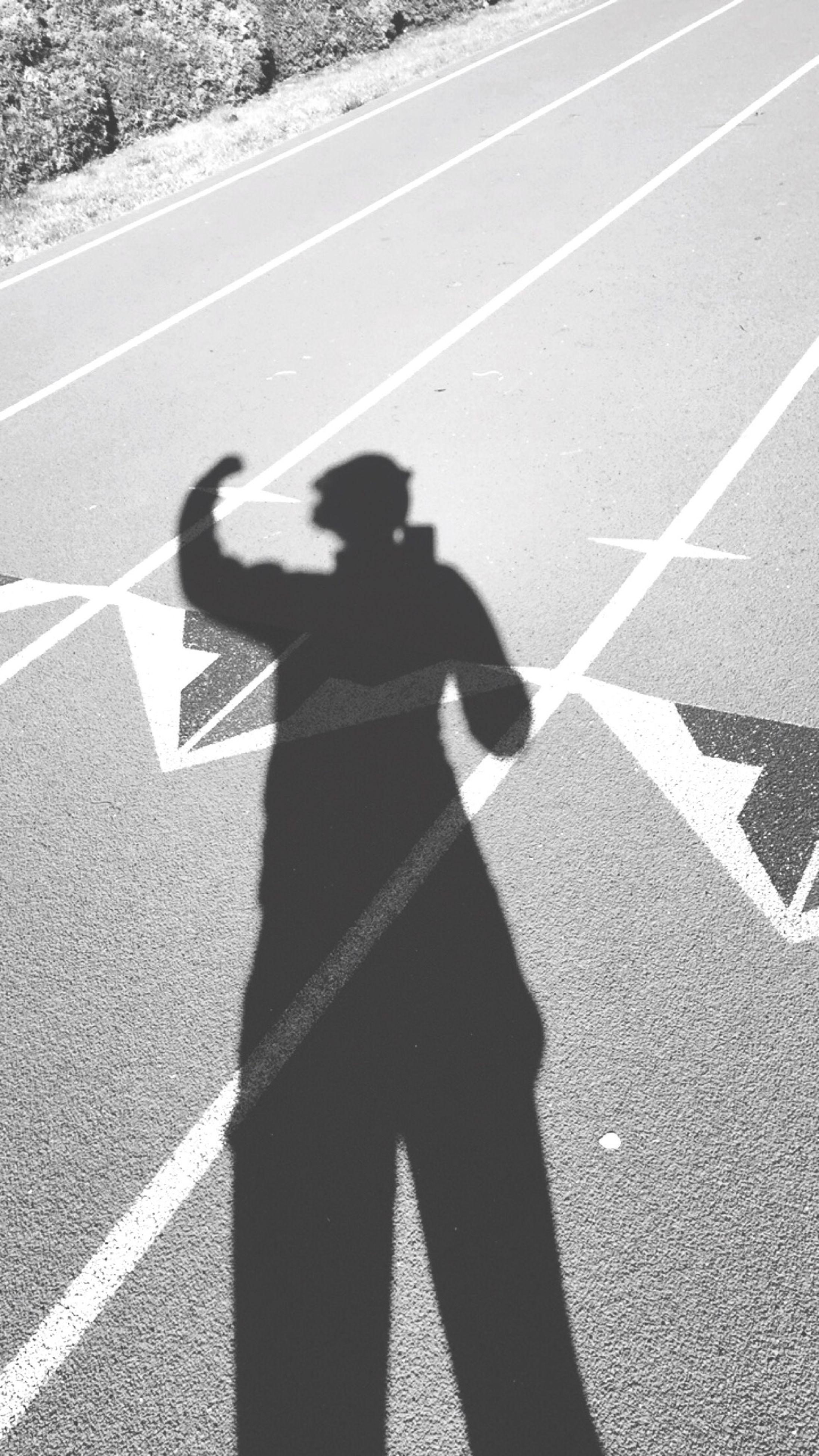 road marking, shadow, transportation, road, street, high angle view, asphalt, sunlight, focus on shadow, guidance, zebra crossing, day, unrecognizable person, arrow symbol, outdoors, human representation, the way forward, lifestyles