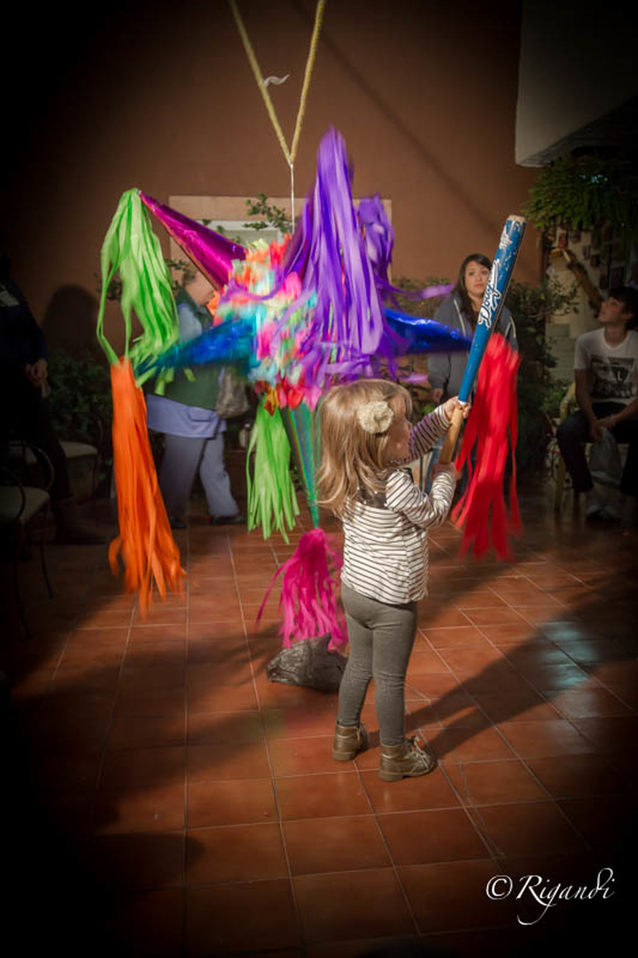la piñata Adult Cheerful Child Childhood Children Only Dancing Enjoyment Friendship Full Length Fun Girls Human Body Part Indoors  Motion Multi Colored Night People Piñata Smiling Togetherness