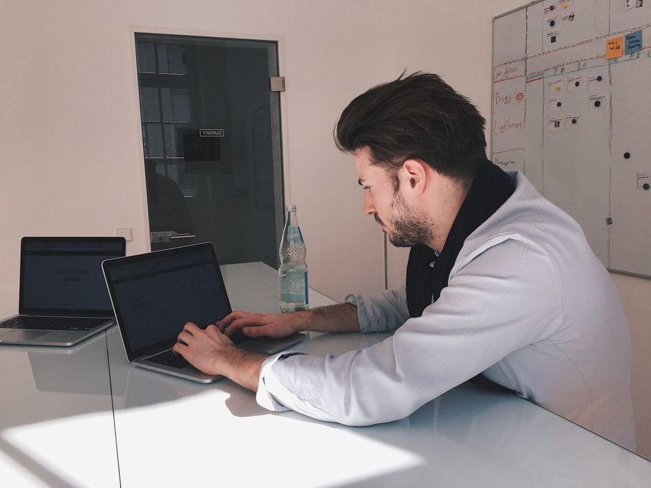 Technology One Person Laptop Real People Wireless Technology Using Laptop Computer Connection Communication Indoors  One Man Only Young Adult Working Startup Office