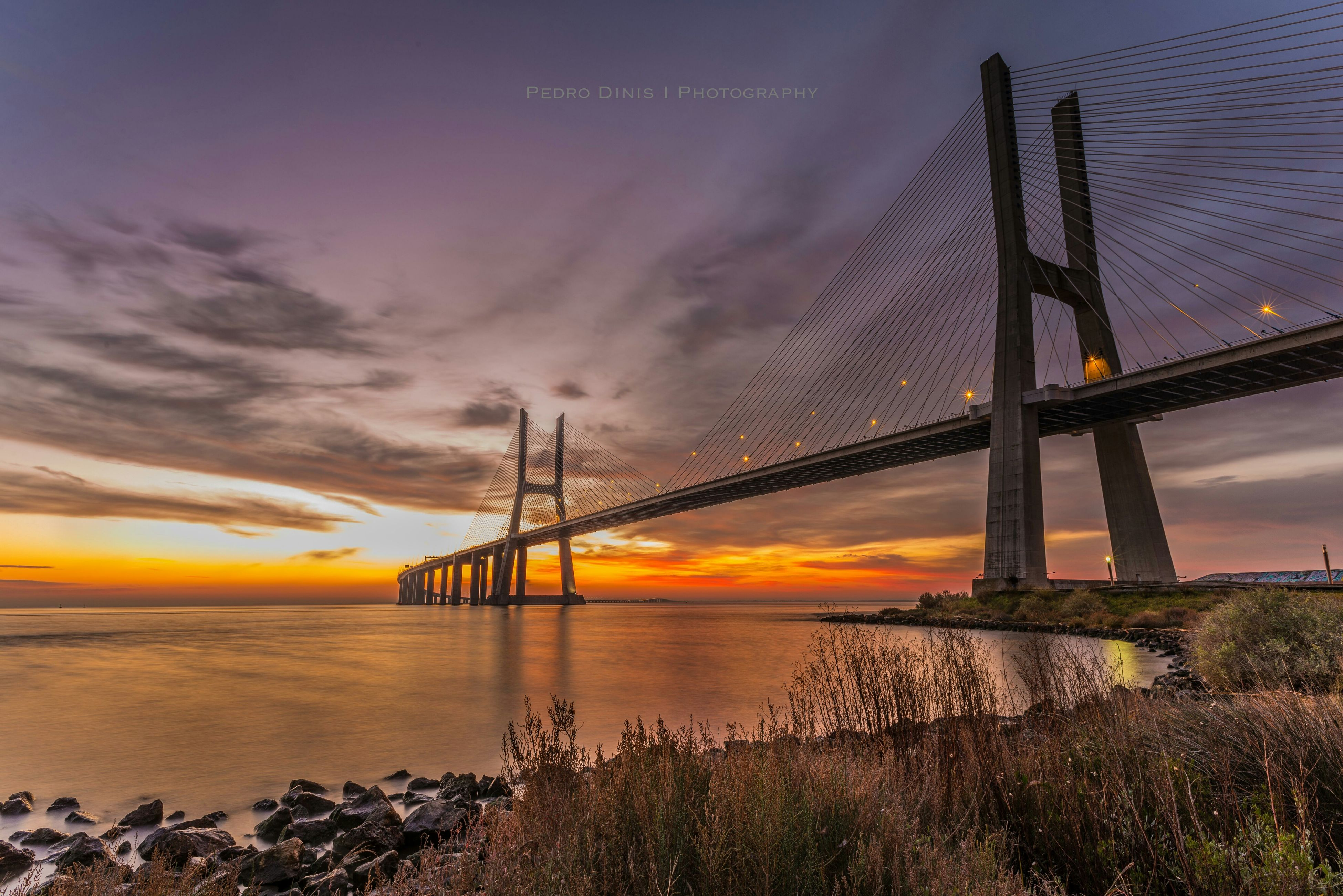 sunset, water, sea, sky, connection, built structure, scenics, tranquil scene, tranquility, beauty in nature, cloud - sky, orange color, nature, horizon over water, silhouette, architecture, beach, bridge - man made structure, idyllic, shore
