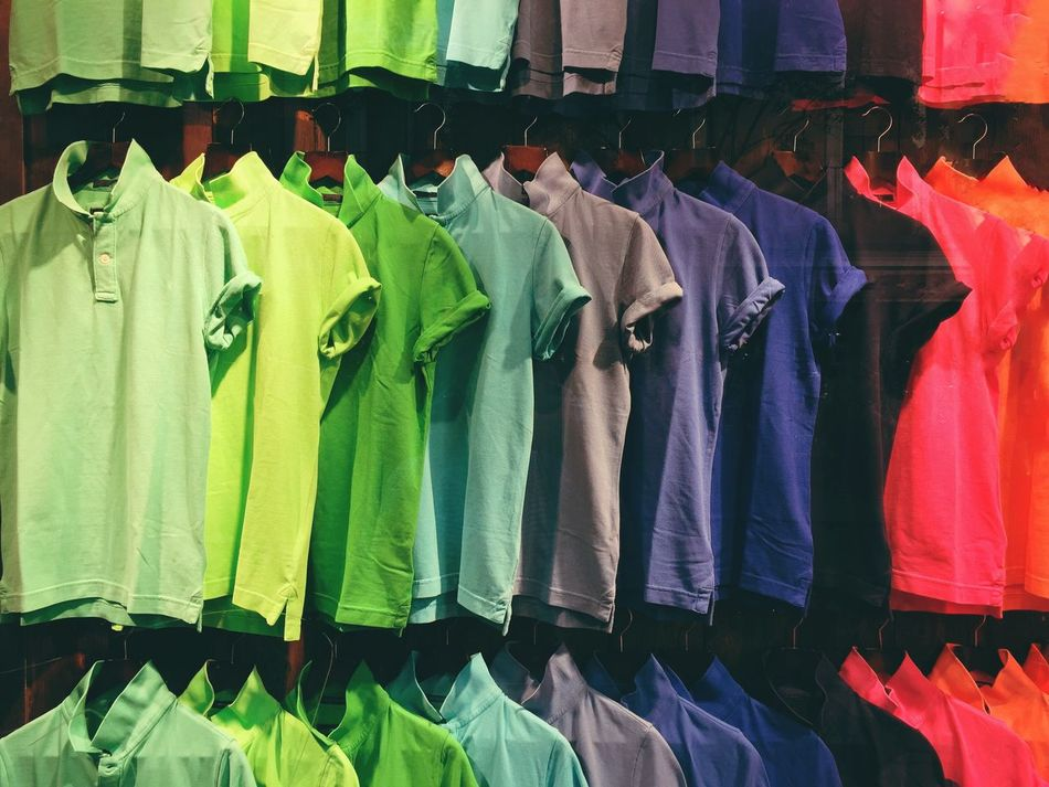 Multi Colored Variation Choice Large Group Of Objects Clothing In A Row Hanging Abundance Fashion Retail  Vibrant Color Sale Arrangement No People Clothing Store Consumerism Indoors  Day T-shirts Shirt