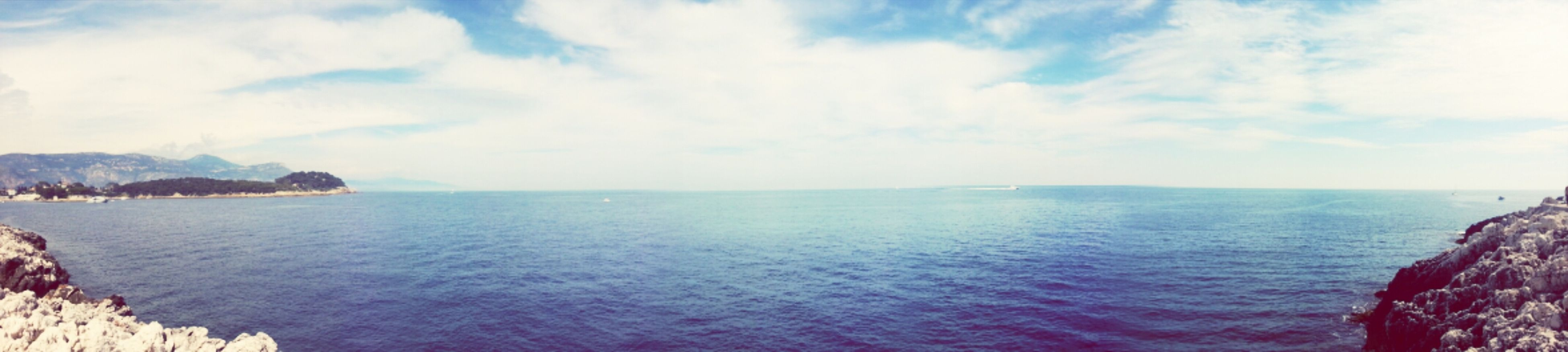 sea, water, horizon over water, sky, scenics, tranquil scene, beauty in nature, tranquility, nature, cloud - sky, idyllic, cloud, cloudy, seascape, panoramic, waterfront, blue, day, outdoors, coastline