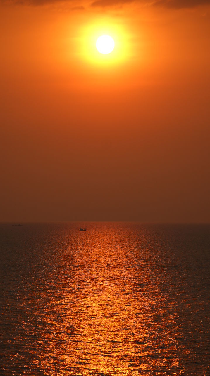 sunset, sun, orange color, sea, beauty in nature, scenics, nature, tranquility, tranquil scene, idyllic, horizon over water, sky, water, silhouette, reflection, moon, outdoors, sunlight, no people, clear sky