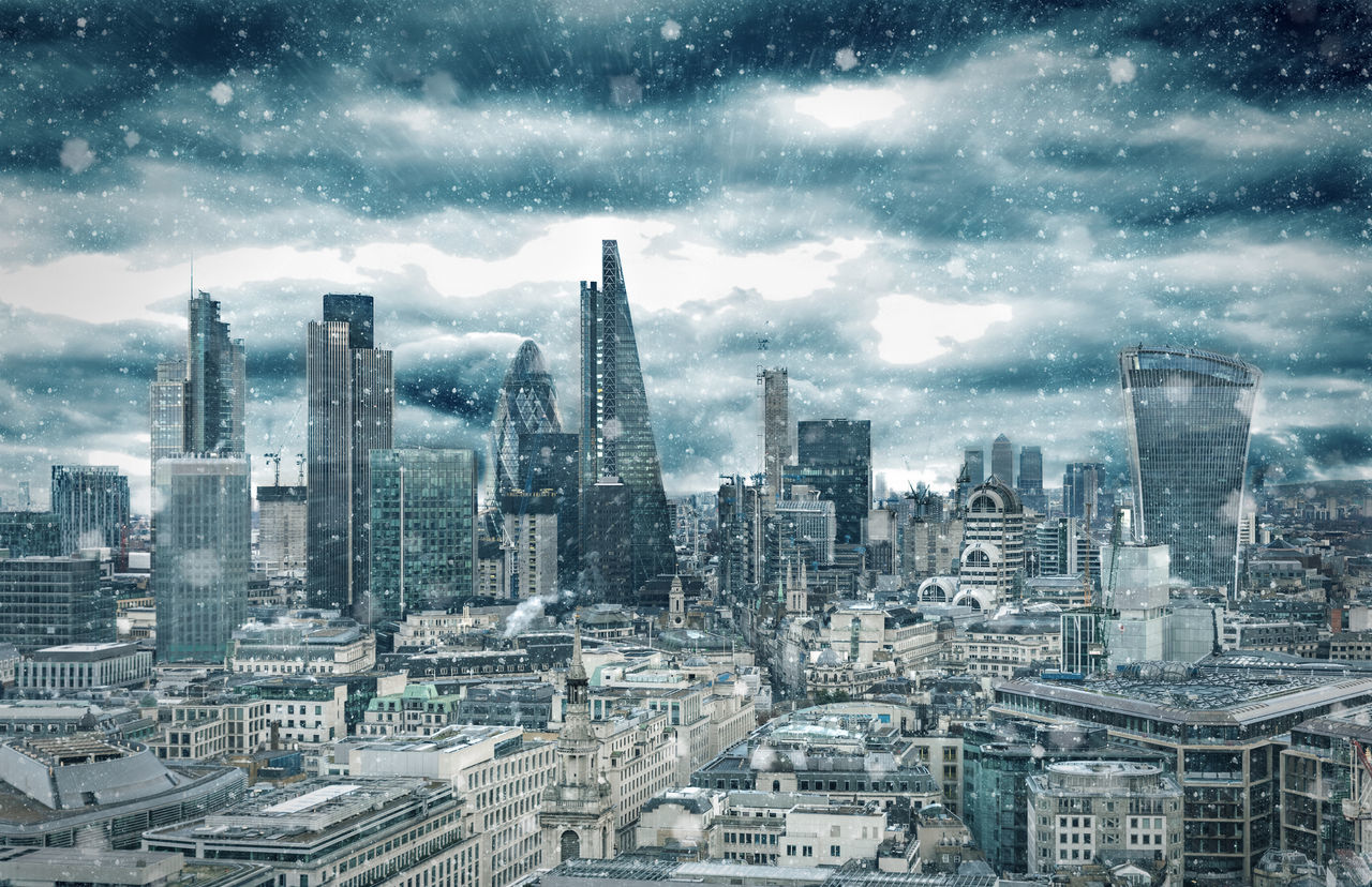 A snowstorm over the City of London on a cold winter day Architecture Bank Blizzard Building Exterior City City Cityscape Cold Financial District  Grey London Modern Sky Skyline Skyscraper Snow Snowfall Storm Tall Tall - High Tower United Kingdom Urban Skyline Winter