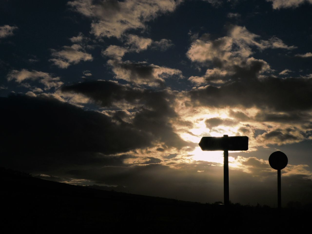 Sunset Signs ... Cloud - Sky Sky Sunbeam No People Cloudscape Outdoors Low Angle View Tranquility Beauty In Nature Road Sign Nature Storm Cloud Day Drivebyphotography Silouette Photography Silhouette Clouds Clouds And Sky Dramatic Sky Landscape