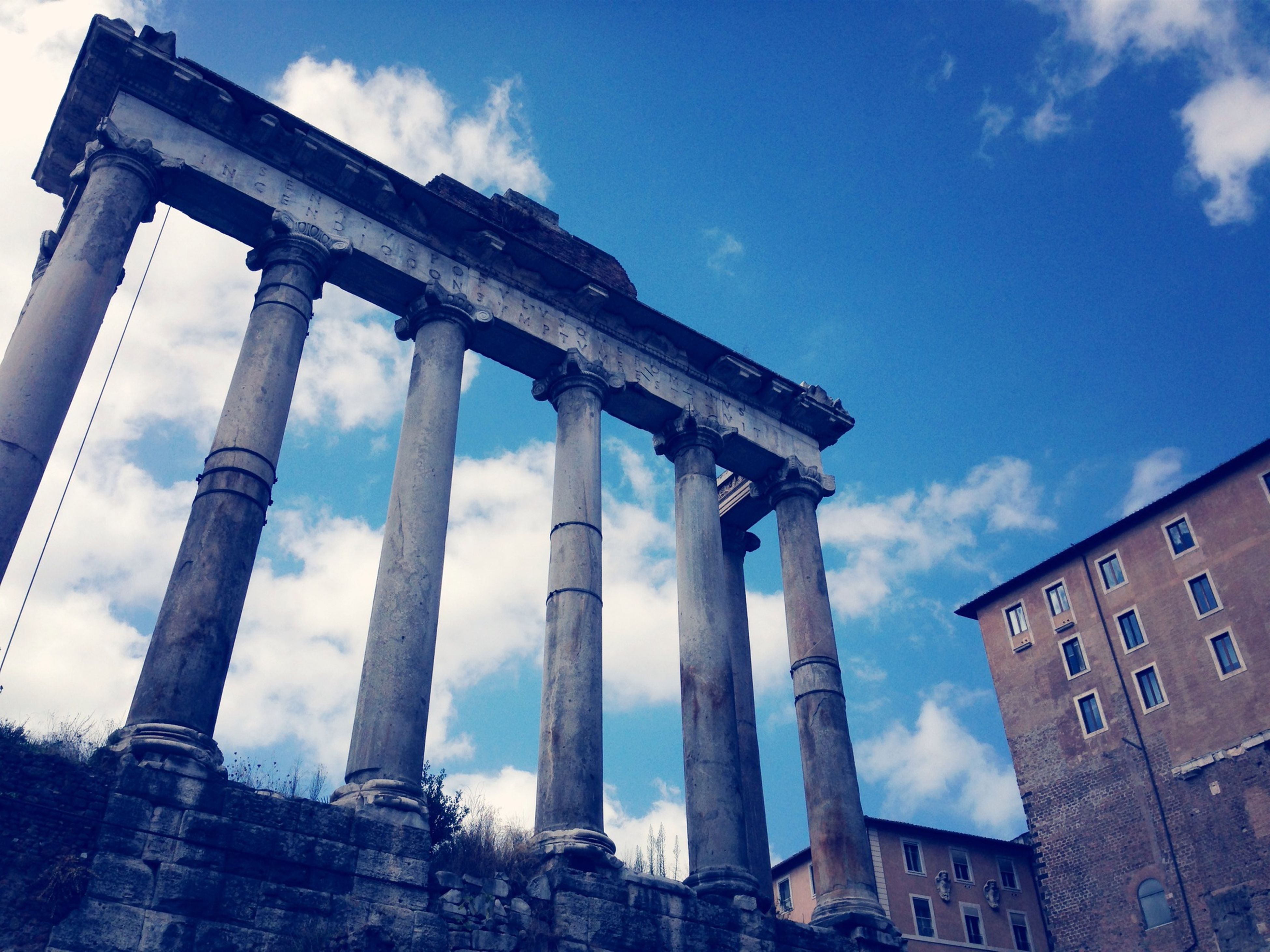 architecture, built structure, building exterior, history, low angle view, sky, famous place, travel destinations, tourism, cloud - sky, travel, international landmark, architectural column, capital cities, the past, old, ancient, column, old ruin, city