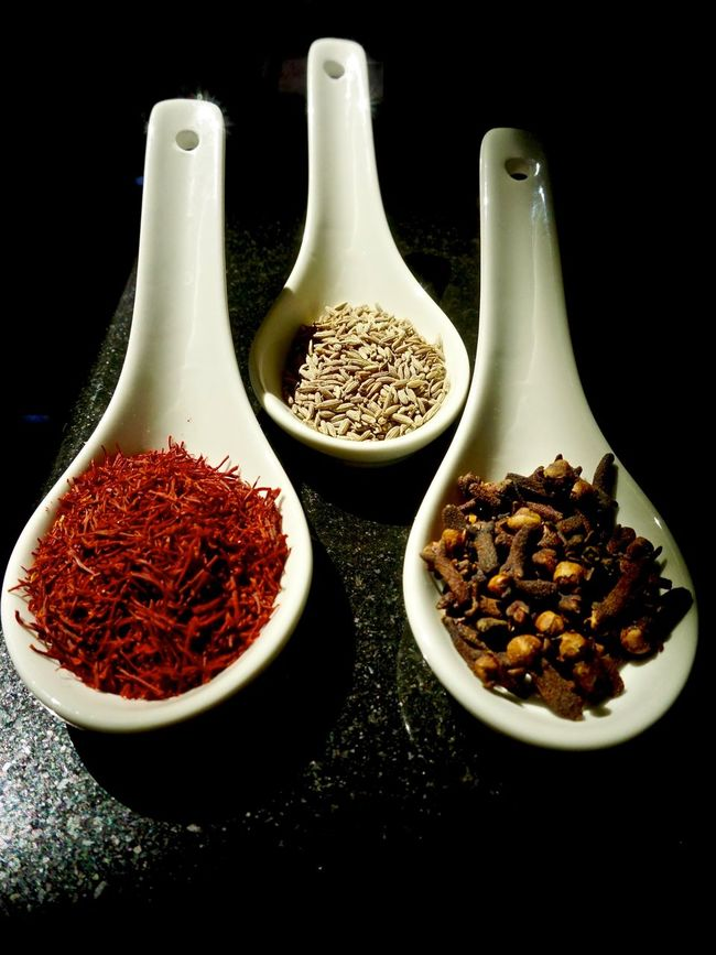 Saffron, Cumin and cloves displayed in set of spoons Arrangement Black Background Choice Close-up Cloves Cooking Cumin Seed Food Freshness Group Of Objects Healthy Eating Indian Spices No People Organic Red Saffron Selective Focus Serving Size Spice Spoons Still Life Studio Shot