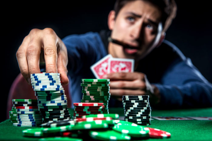 Poker player. Gambling concept Blackjack Casino Gambling Jackpot Man Poker Addiction Casino Entertainment Gambler Gambling Gambling Chip Game Leisure Games Luck Male Player Playing Playing Card Games Poker - Card Game Poker Chips Poker Game Selective Focus Studio Shot Young Adult