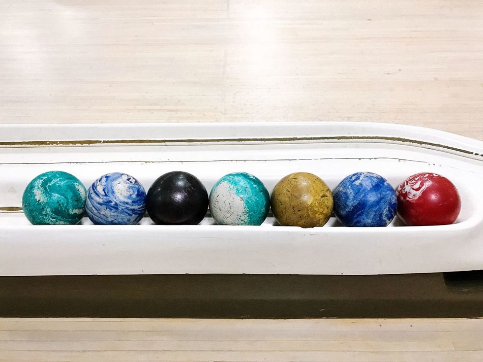 Duckpin bowling balls. Connecticut, USA. Photo by Tom Bland. Multi Colored Indoors  No People Leisure Activity Looking Down Bowling Balls Americana Bowling Alley Bowling Duckpin Bowling IPhone IPhoneography