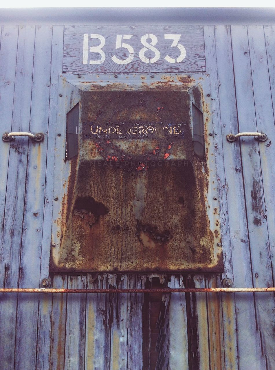 Art Is Everywhere Text Door Close-up Day Abandoned No People Outdoors Weathered Communication Rusty Rail Railway Railroad Wagon  Rustic Haze Underground Transport Transportation Decay