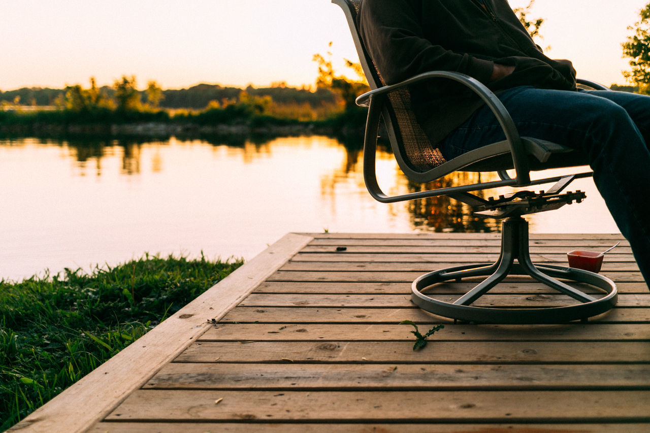Chair Chilling Cottage Day Enjoyment Lake Lakeside Low Section Nature One Man Only One Person Outdoors People Reflection Sky Summer Sunset Tranquility Water Weekend Activities