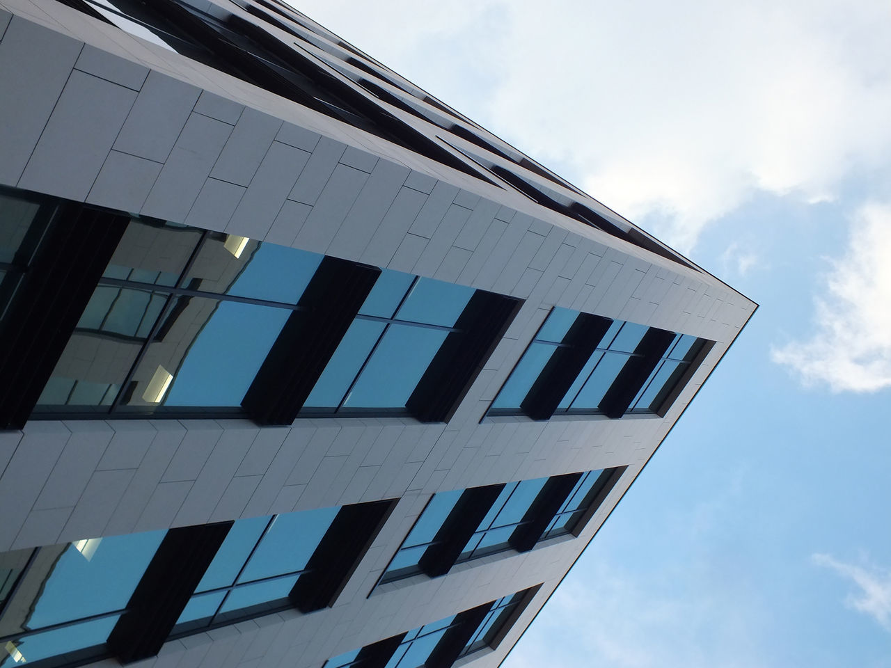 architecture, built structure, building exterior, low angle view, modern, window, sky, cloud - sky, day, no people, outdoors, skyscraper, city