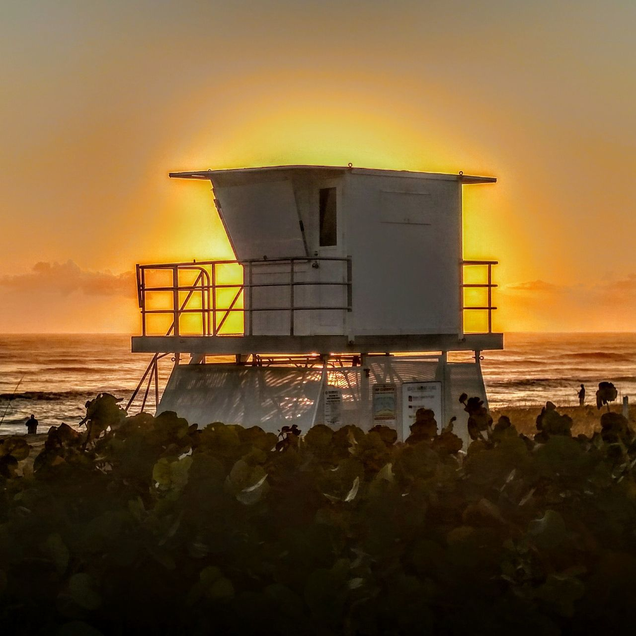sunset, sea, lifeguard hut, beach, silhouette, water, horizon over water, built structure, nature, beauty in nature, scenics, sky, sun, outdoors, building exterior, no people, day