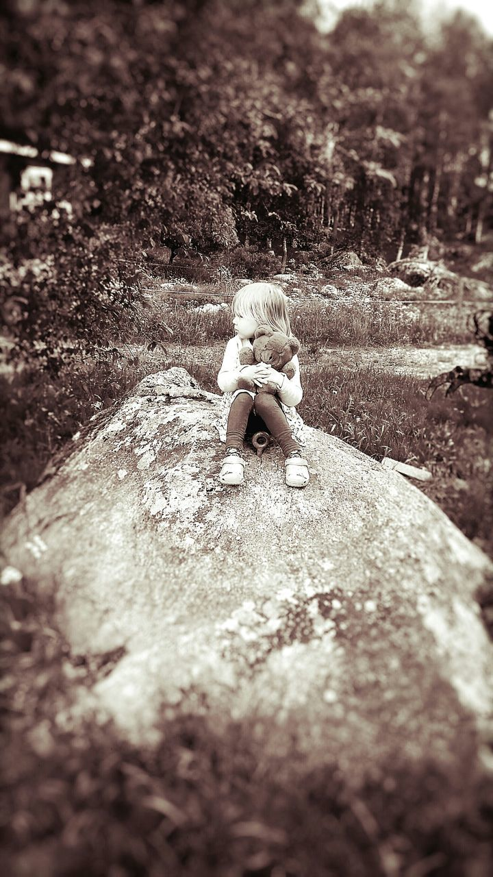 childhood, one person, selective focus, day, real people, outdoors, nature, blond hair, full length, tree, people