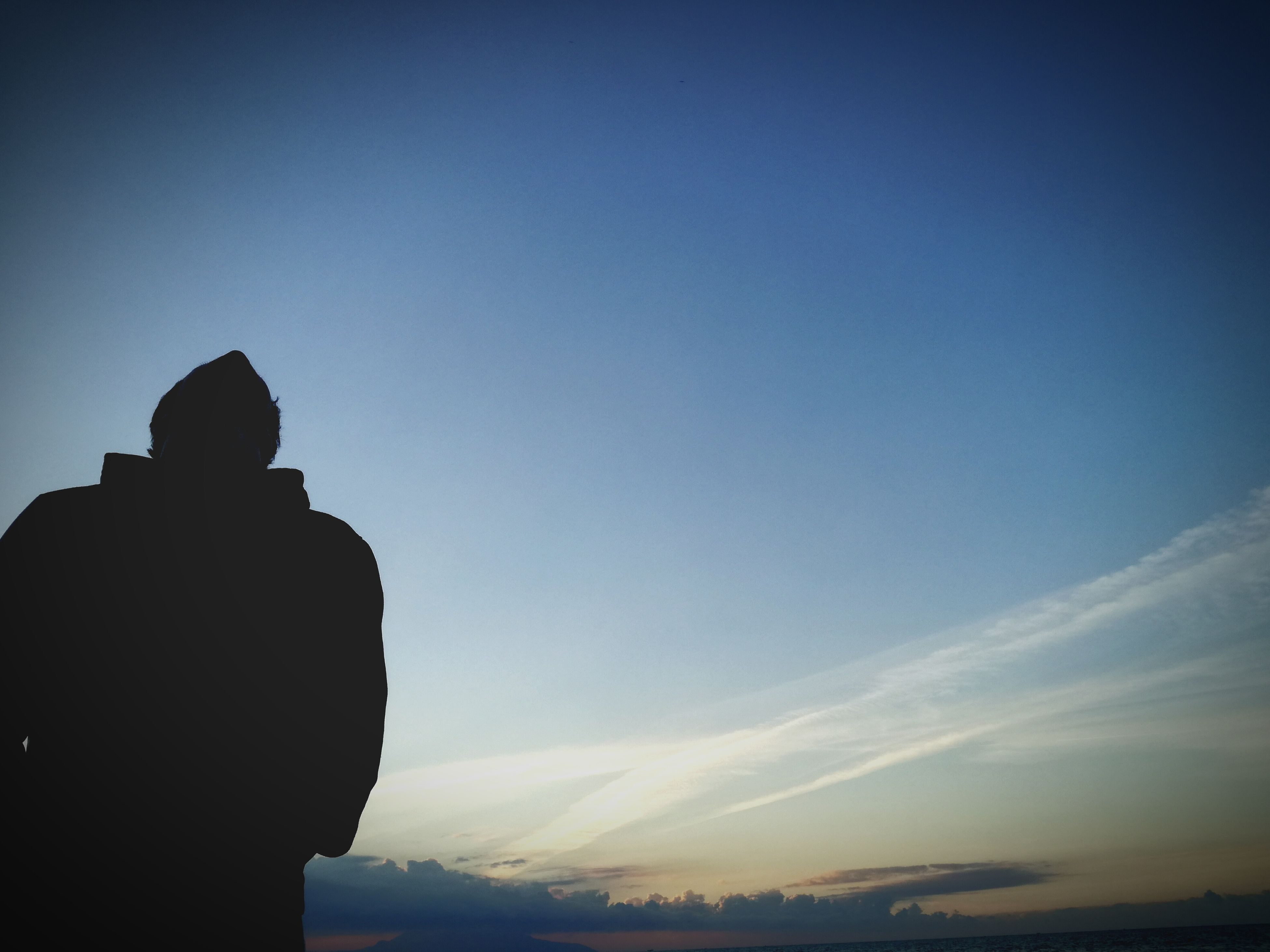 silhouette, sky, one person, one man only, sunset, only men, men, outdoors, mountain, people, adults only, nature, adult, beauty in nature, day
