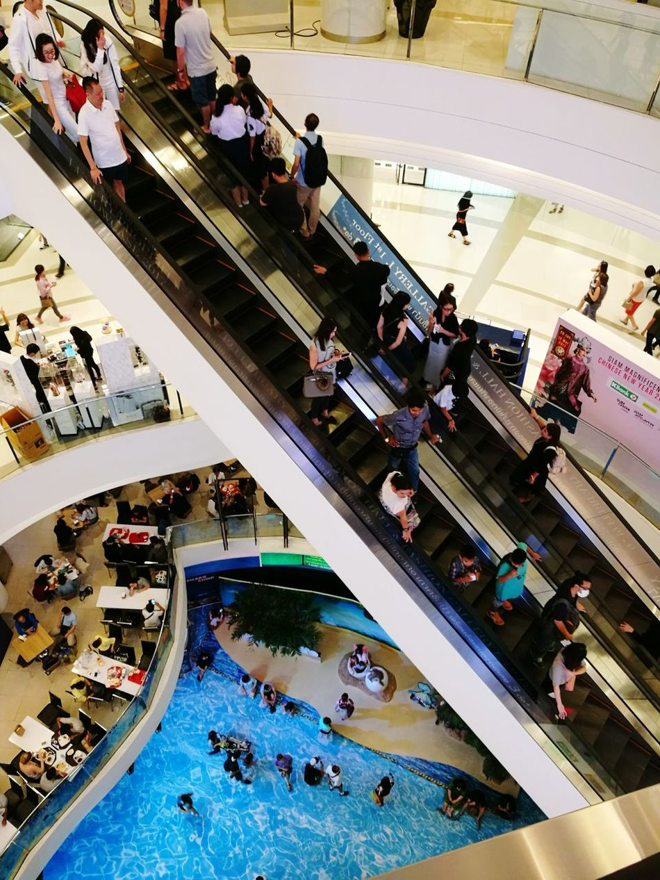 High Angle View Aerial View Large Group Of People Women Men People Adult Day Escalator Escalators Shopping Mall Shopping Centre Shopping Center Floors Floors & Escalators Levels Top Perspective Top Down View Top Down In The City In The Mall