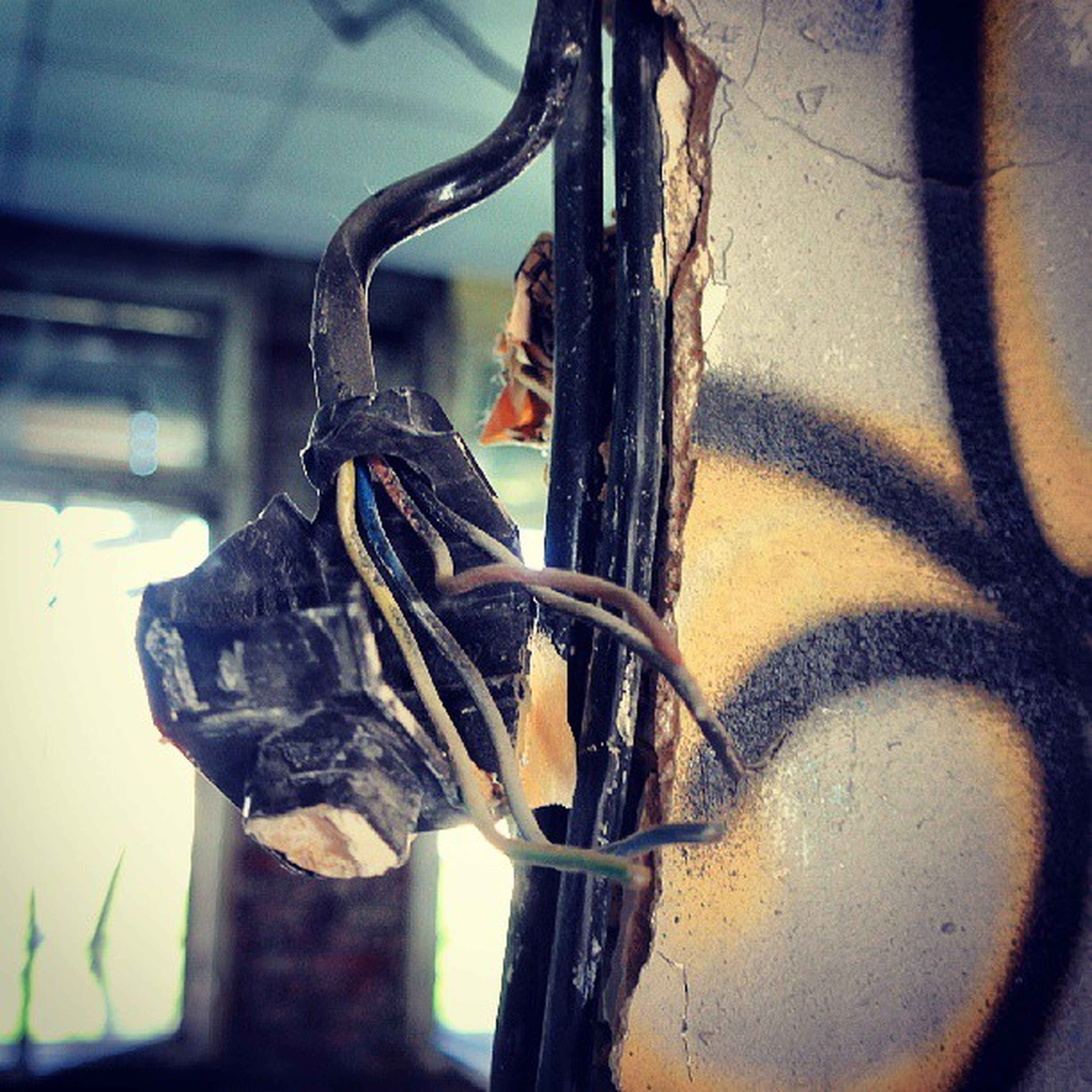 close-up, indoors, focus on foreground, metal, old, art and craft, wall - building feature, art, creativity, no people, day, rusty, window, metallic, built structure, sculpture, statue, wall, selective focus, architecture