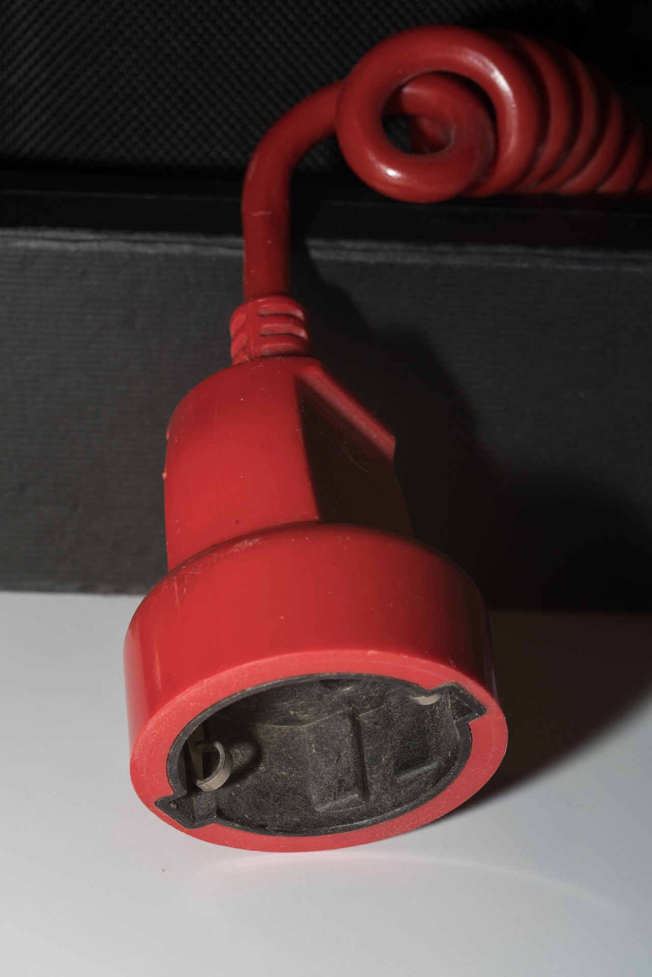 More or less useless and dusty objects in my bureau: AC-Cable - useful AC/DC Plug Close Up Close-up Illuminated Indoors  Indoorsphotography Macro No People One Object Plug Protection Red Safety Spiral Cable Studio