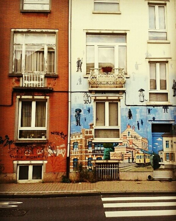 Street art in Bruxelles ~ Belgique Building Exterior Architecture Balcony Shot Window Outdoors No People Built Structure Facade ArtWork Streetphotography Streetart BruxellesmabelleBelgium Magritteinspired Magritte Houses Street Art/Graffiti Eye4photography  Magritte Tribute Surrealism
