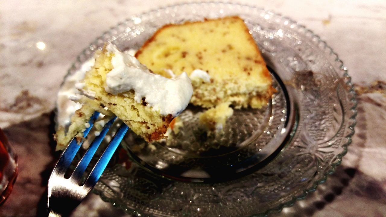 High Angle View Of Cream Cake On Fork