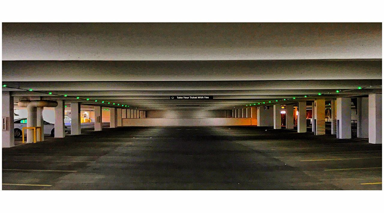 Parking Garage. Picturing Las Vegas Architecture Built Structure Architectural Column Ceiling In A Row The Way Forward No People Corridor Indoors  Illuminated Day Basement The Street Photographer - 2017 EyeEm Awards Malephotographerofthemonth This Week On Eyeem Eyeemphoto IPhoneography City Architecture The Architect - 2017 EyeEm Awards Minimalism Minimalobsession Minimalist Architecture