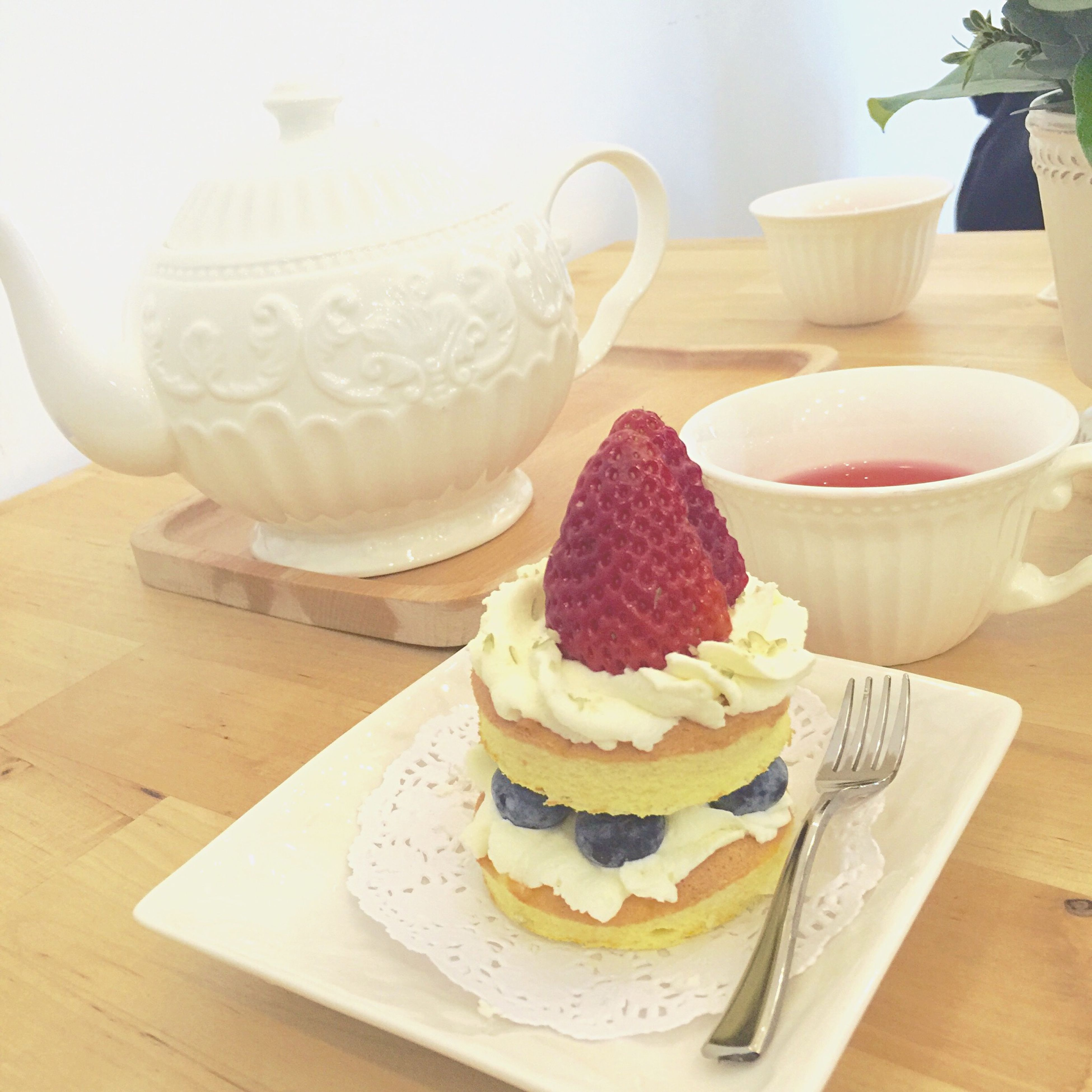 indoors, food and drink, table, freshness, sweet food, still life, plate, dessert, food, ready-to-eat, indulgence, coffee cup, drink, cake, unhealthy eating, refreshment, serving size, high angle view, saucer, decoration