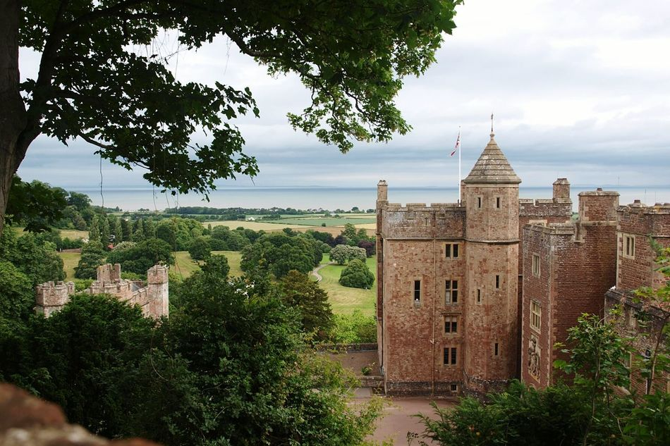 Dunster Castle Dunster Coastal View Stone Castle Building Old Building  Historical Building Trees Outlook from the Gardens on the site of the original Hill Fort