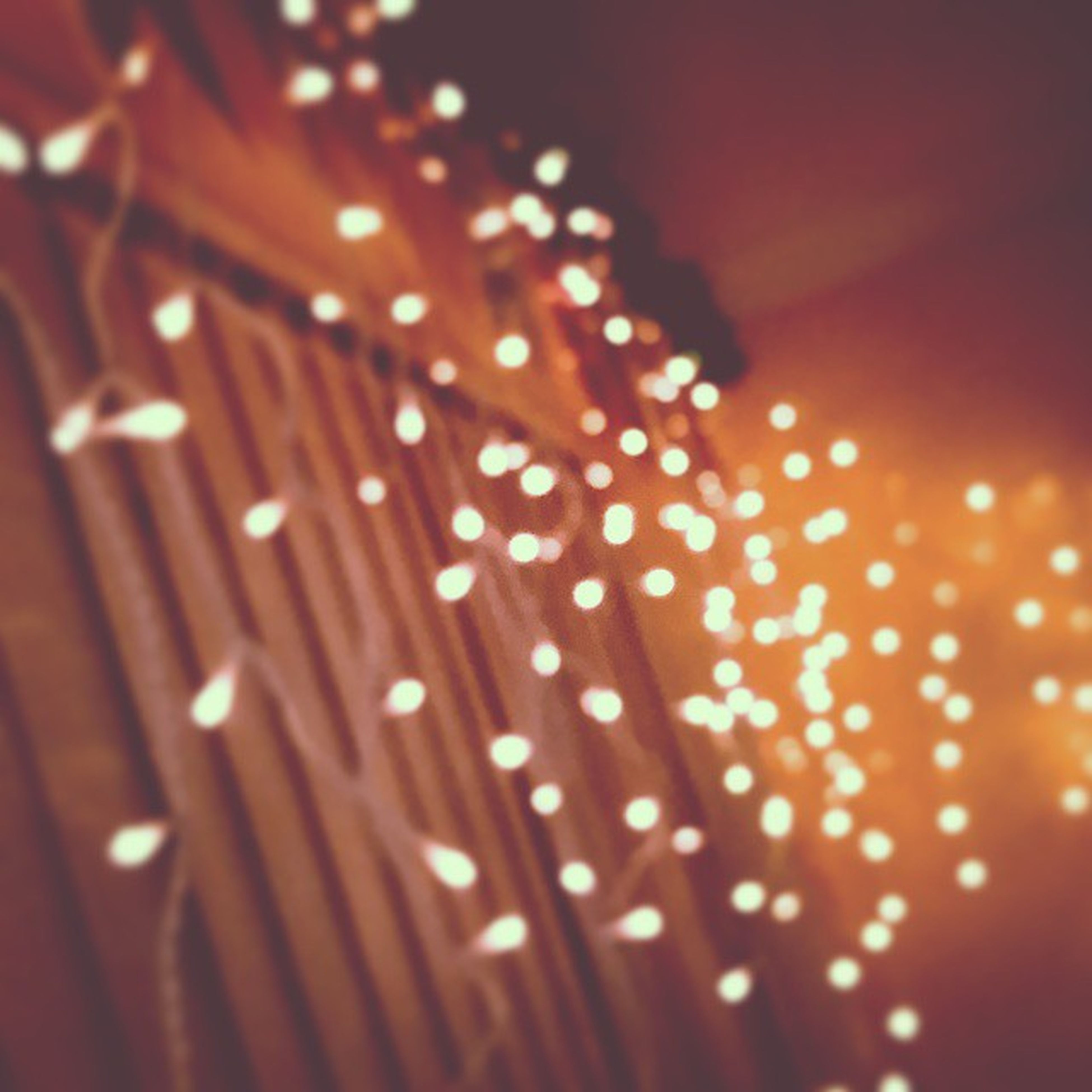 illuminated, night, close-up, pattern, indoors, selective focus, lighting equipment, decoration, no people, wood - material, focus on foreground, glowing, light - natural phenomenon, hanging, design, textured, backgrounds, still life, red
