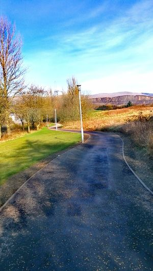 Long and winding road Landscape Nature No People Sky Beauty In Nature Outdoors Tree Tranquility Empty Places Lonely Road Springtime Pathway Street Light Urban Photography Scotland Path To Nowhere Huawei P9 Leica Urban Life Clear Sky Sunlight The Way Forward Long And Winding Road Green Color Grass Asphalt