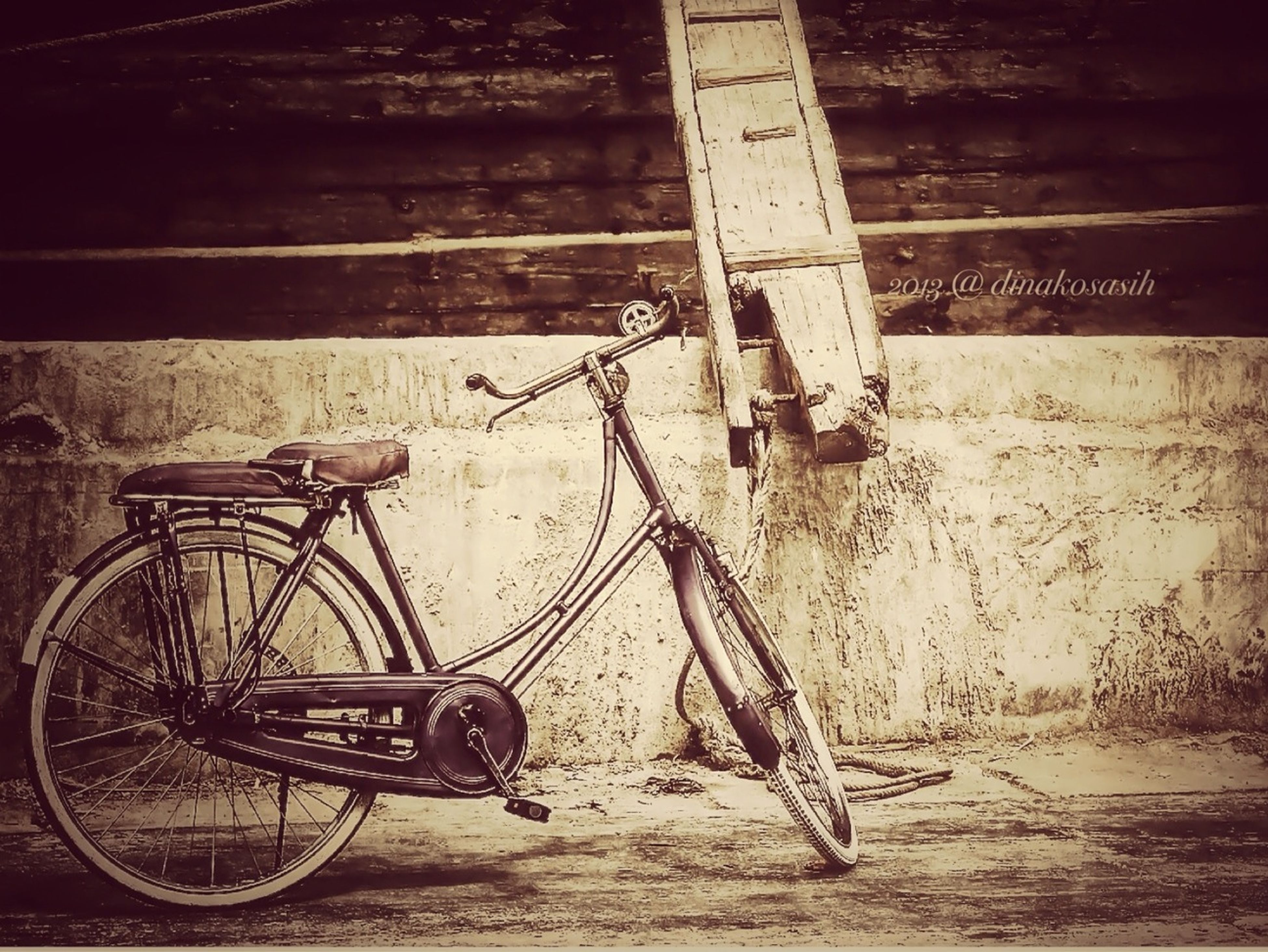 bicycle, transportation, mode of transport, stationary, wall - building feature, parking, land vehicle, parked, metal, built structure, wheel, absence, architecture, no people, day, railing, outdoors, wall, leaning, sidewalk