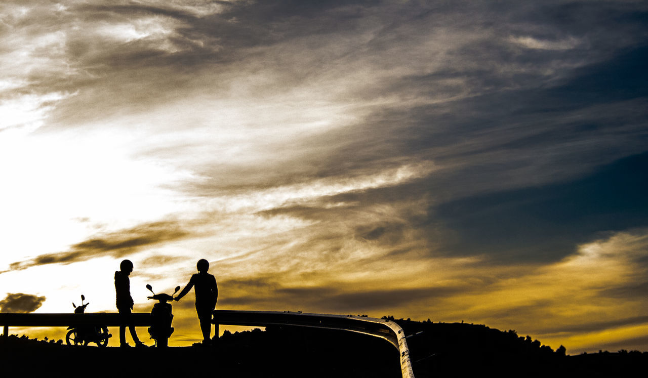 cloud - sky, sky, silhouette, transportation, real people, outdoors, nature, sunset, mode of transport, land vehicle, togetherness, men, two people, lifestyles, day, beauty in nature, friendship, tree, people