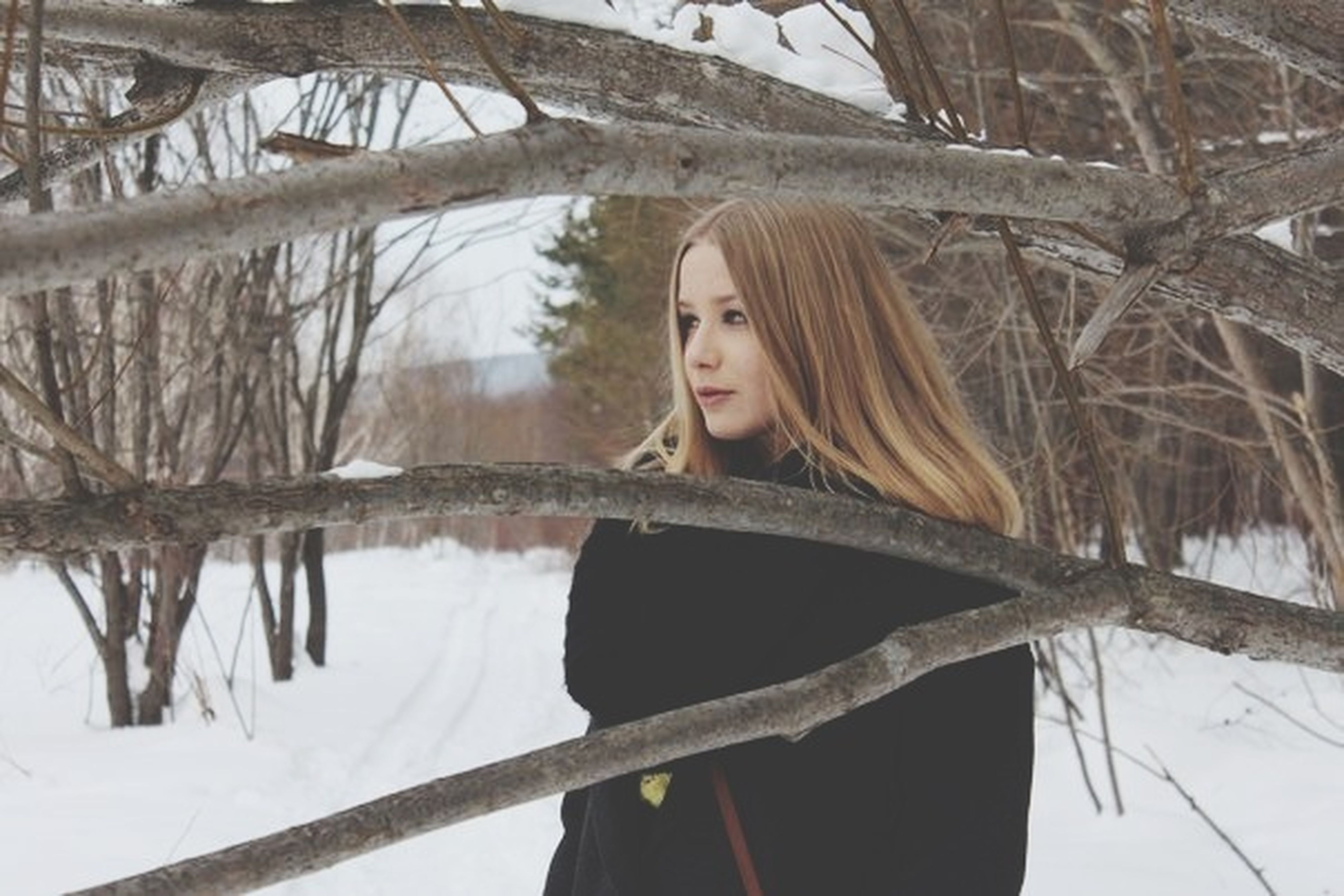 tree, lake, young adult, lifestyles, winter, snow, leisure activity, cold temperature, water, portrait, person, young women, standing, reflection, looking at camera, nature, front view, casual clothing