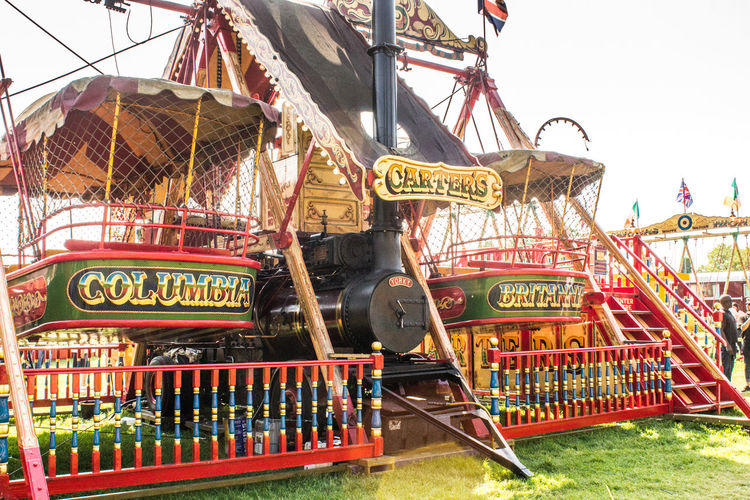 Amusement Park Arts Culture And Entertainment Amusement Park Ride Rollercoaster Traveling Carnival Carousel Outdoors Day Multi Colored No People Architecture City Sky Amusement  Vintage Funfair Streetphotography Fun Ornate Rides Tradition