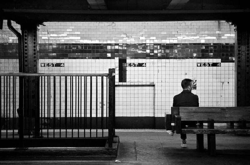 City Life Man Sitting On Bench With Dog Waiting For A Train West 4th St Subway Station NYC