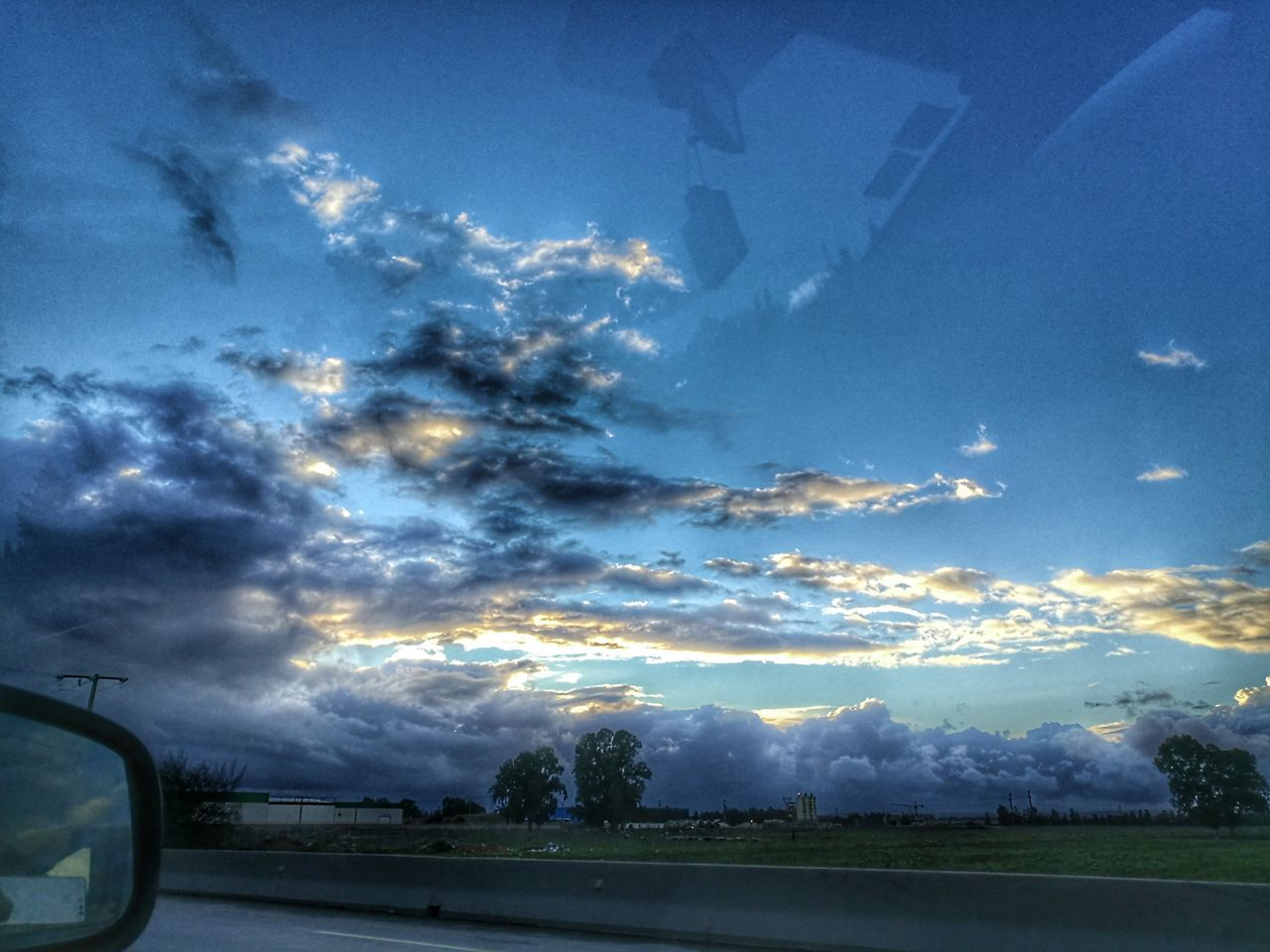 sky, cloud - sky, transportation, car, road, mode of transport, nature, land vehicle, no people, tree, day, outdoors, beauty in nature