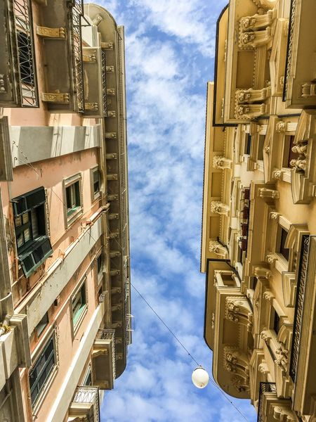 Architecture Building Exterior Built Structure Low Angle View Sky Outdoors Cloud - Sky Day No People Confrontation