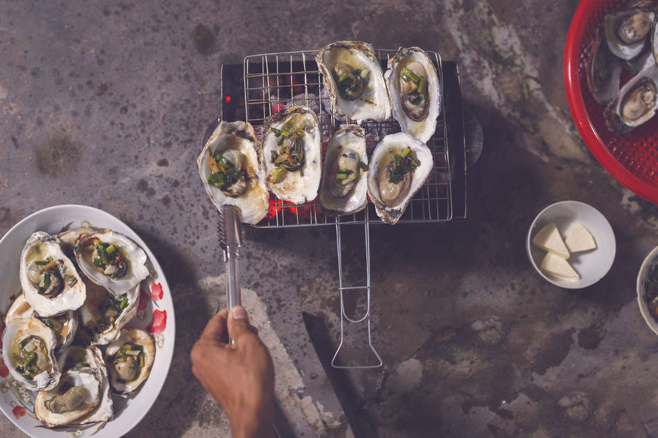 Grilled oysters Oysters ASIA Bowl Cuisine Cultures Eyeem Food  Family Fire Food Food And Drink Fruit Grilled Hand Healthy Eating Human Hand Lifestyles Seafood Vietnam Vietnamese Food Women