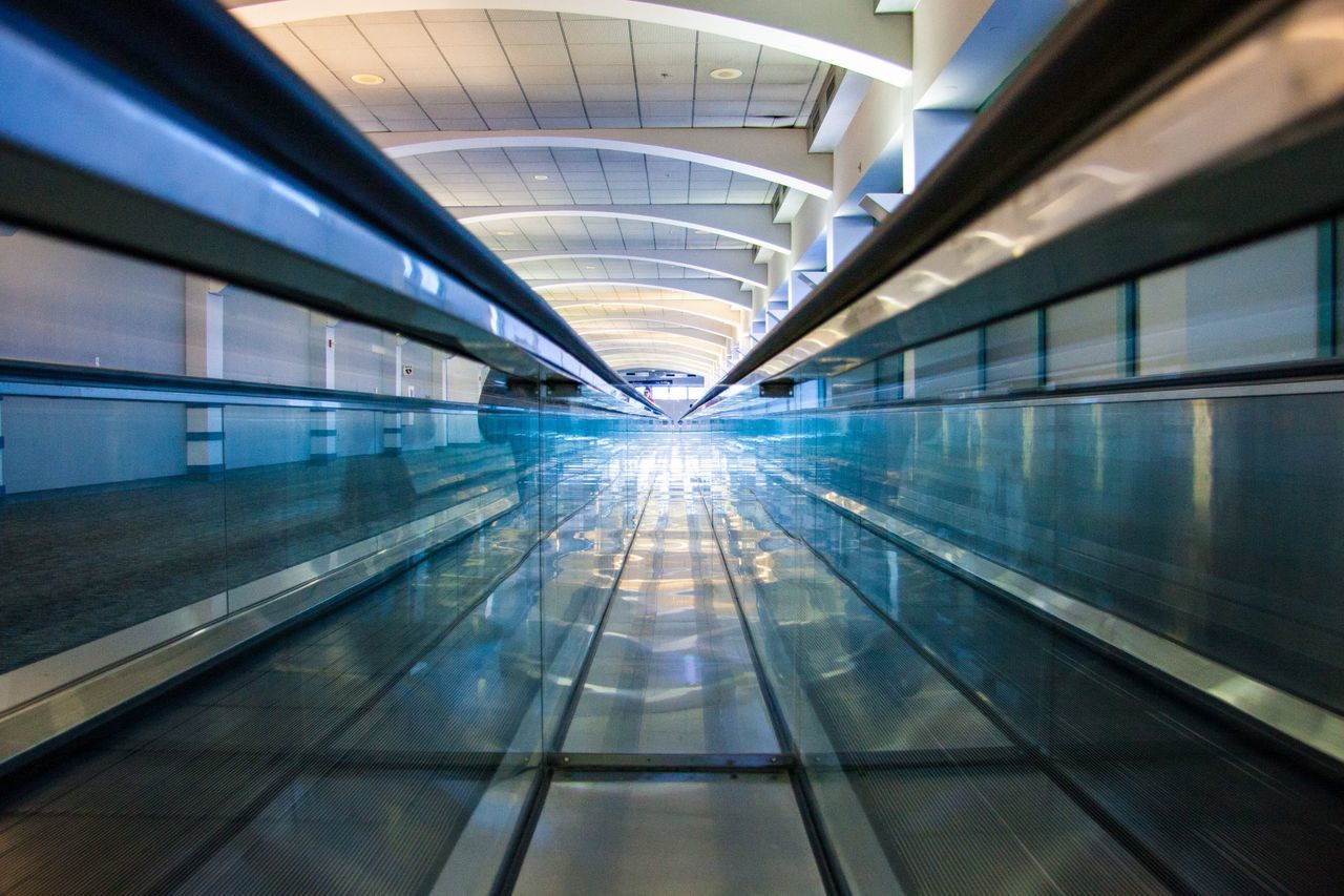 indoors, architecture, the way forward, transportation, modern, airport, illuminated, motion, built structure, convenience, technology, no people, futuristic, day