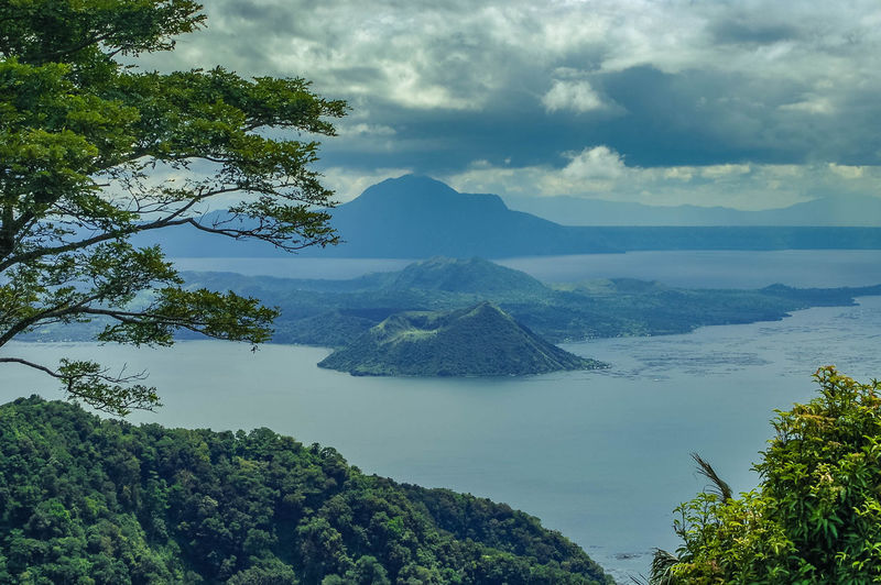 The Taal Volcano in The Philippines. Beauty In Nature Cloud - Sky Day Lake Landscape Mountain Nature Outdoors Philippines Scenics Sky Tagaytay Travel Destinations Tree Volcanic Crater Volcanic Landscape Volcano