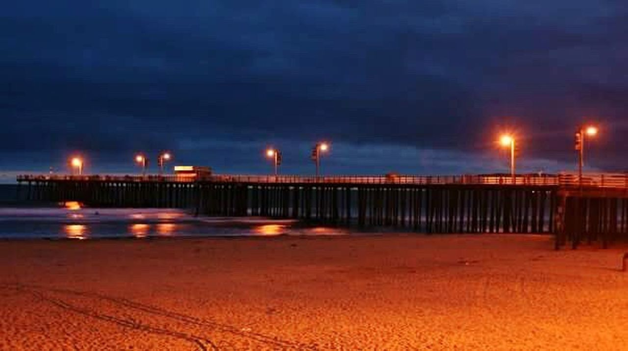 illuminated, night, sky, beach, street light, outdoors, sea, nature, water, built structure, no people, architecture, city